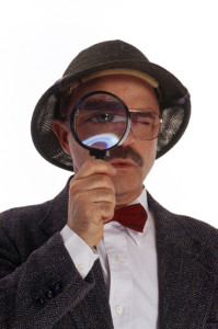 Man-looking-through-magnifying-glass
